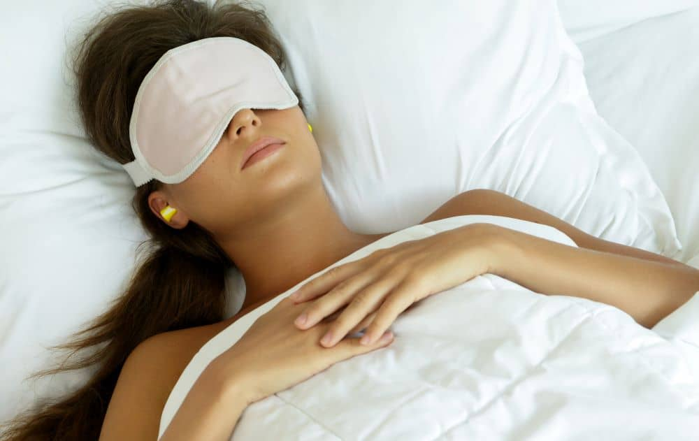 Using ear plugs blocks out all external sound making you fall asleep easy while a sleep mask can give you good sleep.